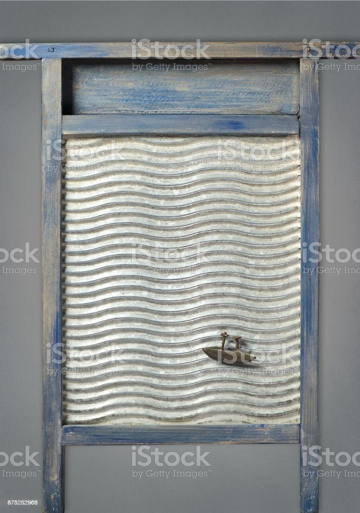 Recycled Art Washboard Ocean With Boat In It stock photo