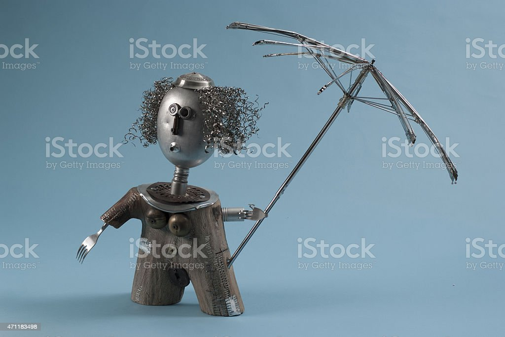 Recycled Art Woman With Umbrella stock photo