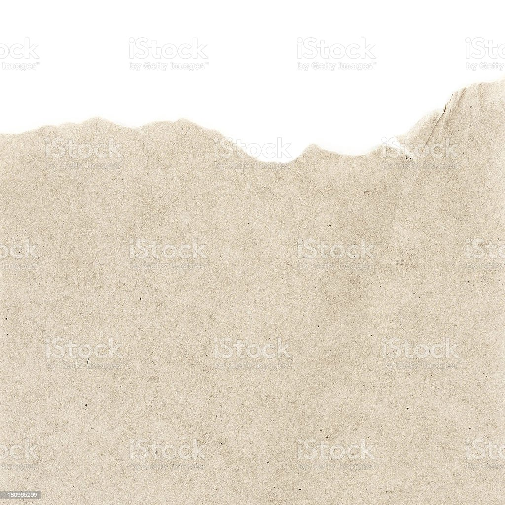 Recycled beige paper  texture or background with Torn edge.  Old stock photo