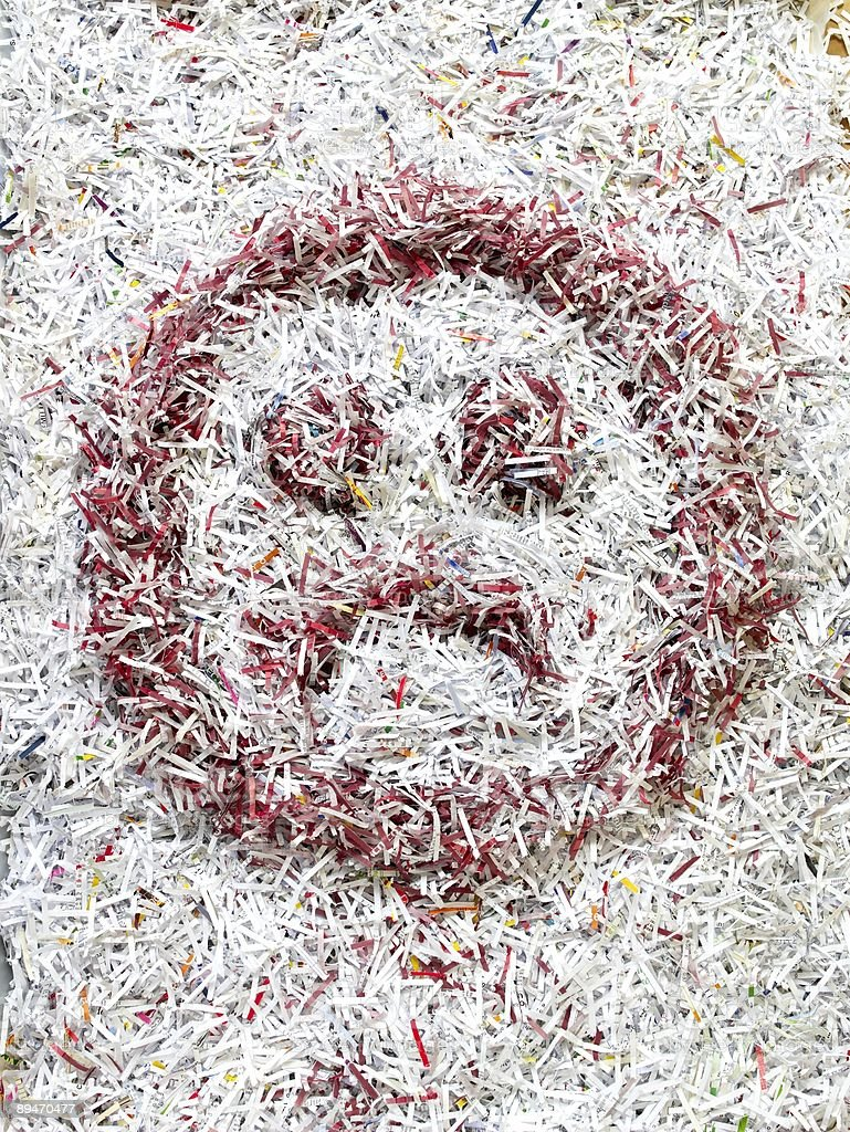 Recycled coloured Shredded Paper Unhappy Face royalty-free stock photo