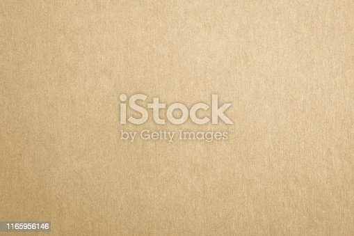 865741954istockphoto Recycled craft paper textured background in antique brown color 1165956146