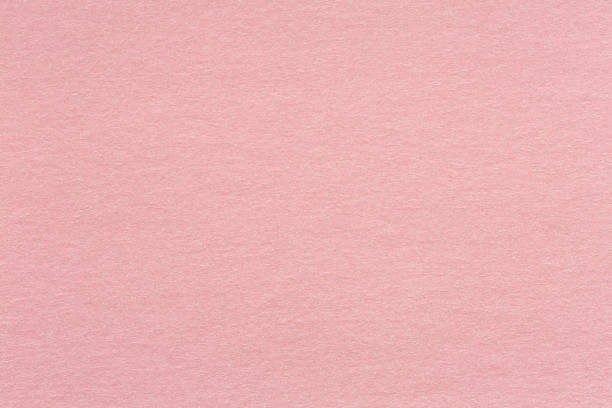 Recycled craft paper textured background in light pink old rose stock photo