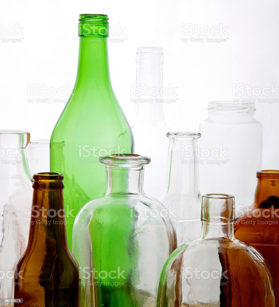 Recycled glass in the shape of bottles on white background royalty-free stock photo