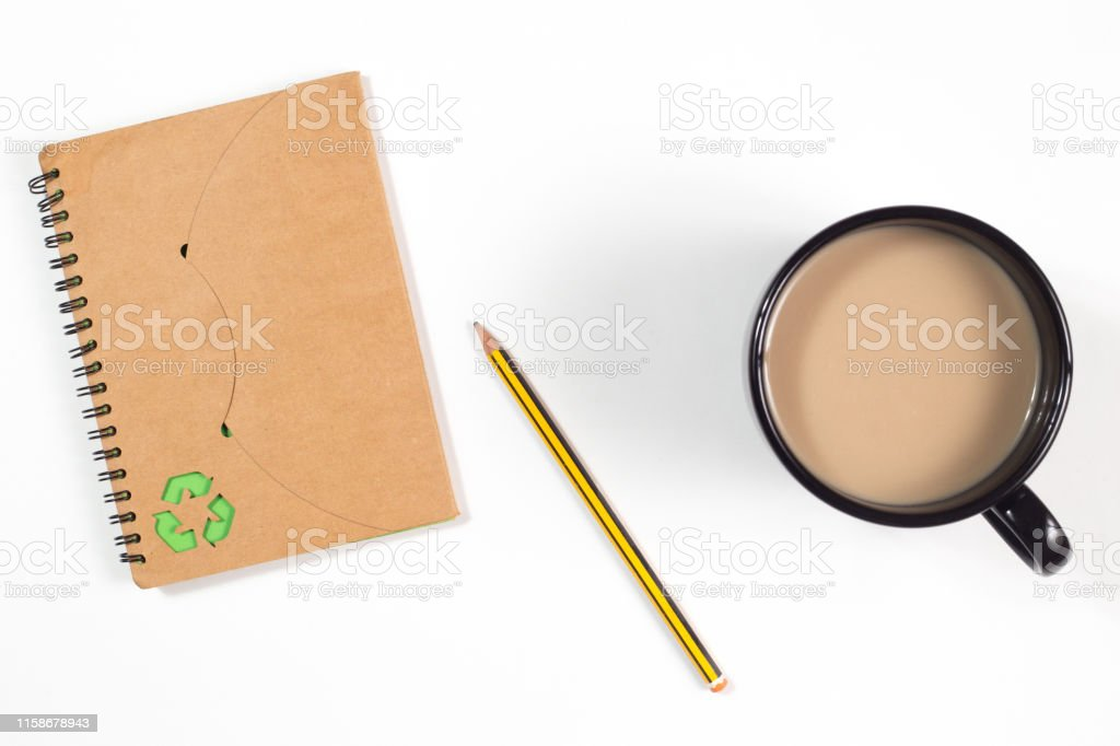 recycled paper notebook and pencil and a cup of coffee recycled paper notebook with recycling symbol and pencil and a cup of coffee on a white background Blank Stock Photo