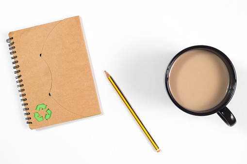 Recycled Paper Notebook And Pencil And A Cup Of Coffee Stock Photo - Download Image Now