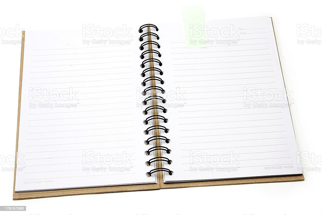 Recycled paper notebook cover open with green reminder royalty-free stock photo