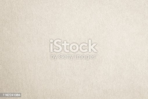865741954istockphoto Recycled paper texture background in cream beige color 1162241384