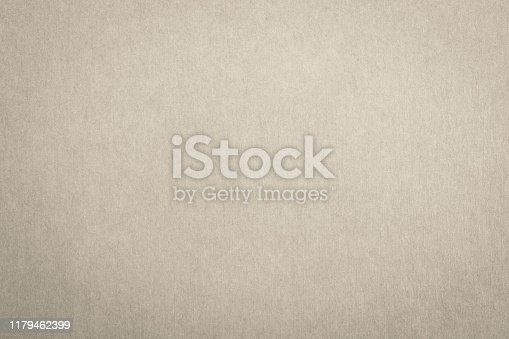 865741954istockphoto Recycled paper texture background in cream beige color 1179462399