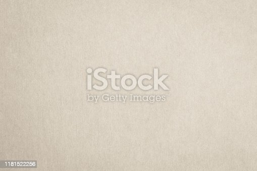 865741954istockphoto Recycled paper texture background in cream beige color 1181522256