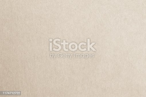 865741954istockphoto Recycled paper texture background in cream color 1174712722