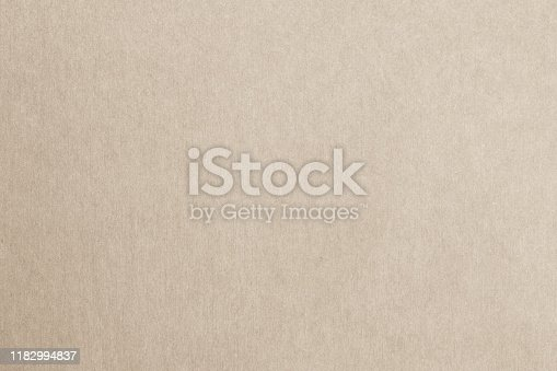 865741954istockphoto Recycled paper texture background in cream color 1182994837