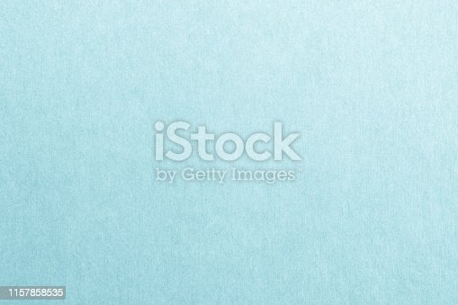 865741954istockphoto Recycled paper texture background in cyan blue color 1157858535