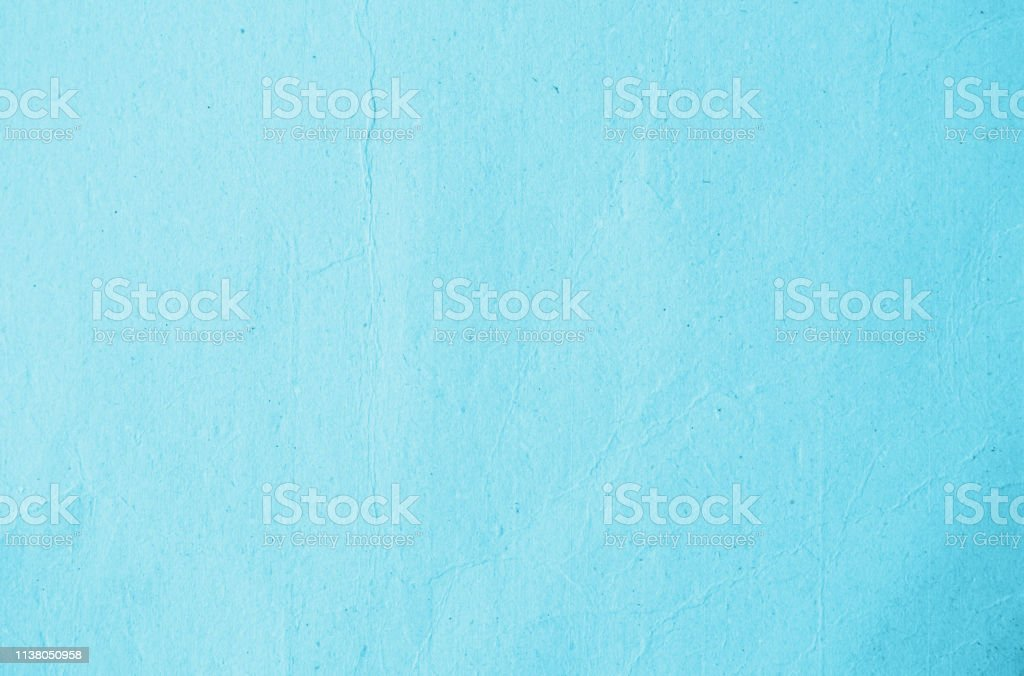 Recycled paper texture background in cyan turquoise teal aqua green...