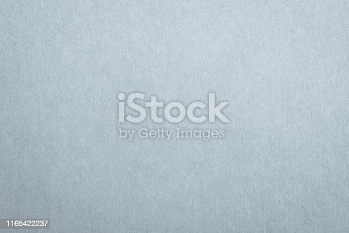 865741954istockphoto Recycled paper texture background in light blue grey color 1165422237