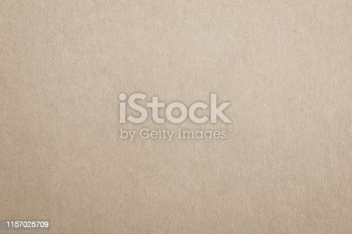 865741954istockphoto Recycled paper texture background in light cream brown color 1157025709