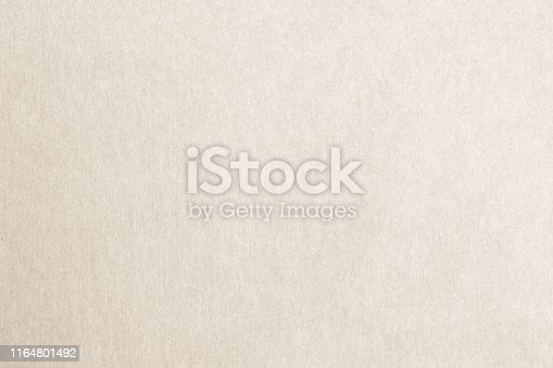 865741954istockphoto Recycled paper texture background in light cream sepia color 1164801492