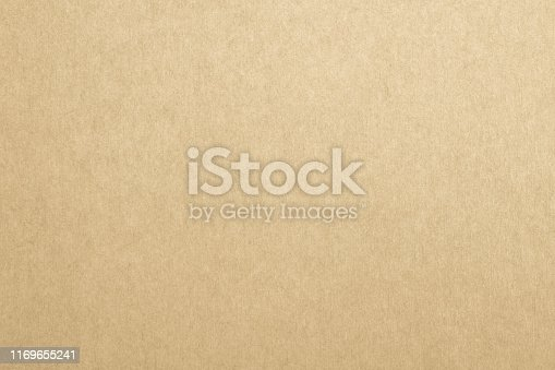 865741954istockphoto Recycled paper texture background in yellow cream color tone 1169655241
