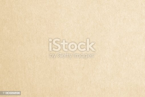865741954istockphoto Recycled paper texture background in yellow cream color tone 1180686896