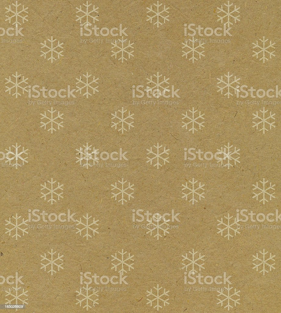 recycled paper with snowflake pattern stock photo