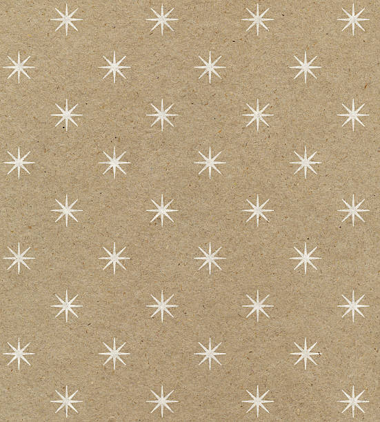 recycled paper with star pattern - wrapping paper stock photos and pictures