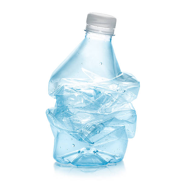 Recycled plastic bottle Squashed plastic bottle in order to recycle. Blue color bottle and white stopper with a soft reflection against white background.Clipping path on the object not on shadow reflection.A few water bubbles to give up a freshness message. crushed stock pictures, royalty-free photos & images