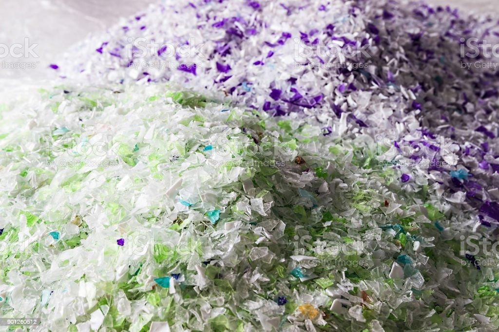 Recycled plastic bottles. Polymeric pellets.  Polymer beads. Polyethylene granules. stock photo