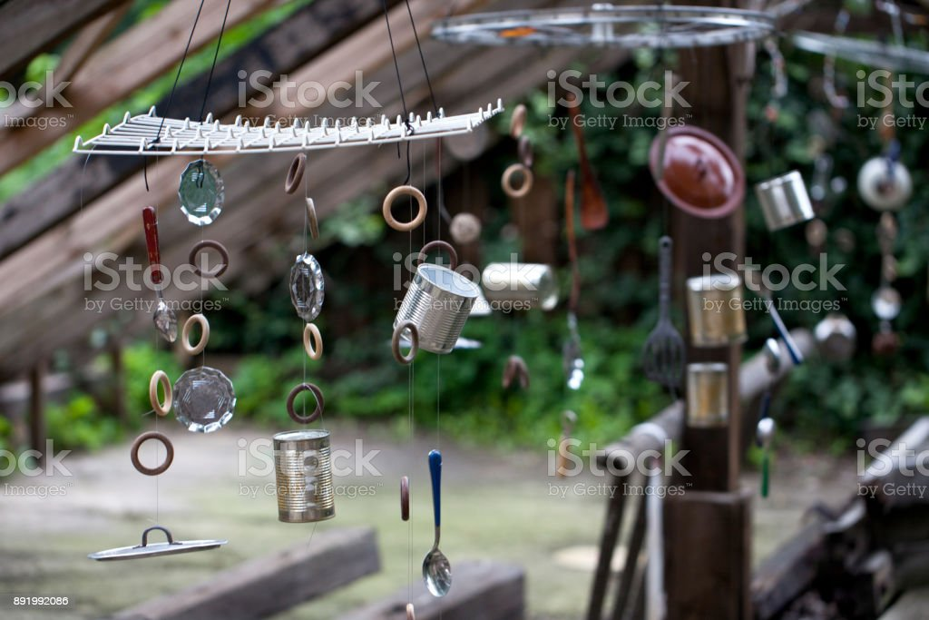 recycled wind chimes stock photo