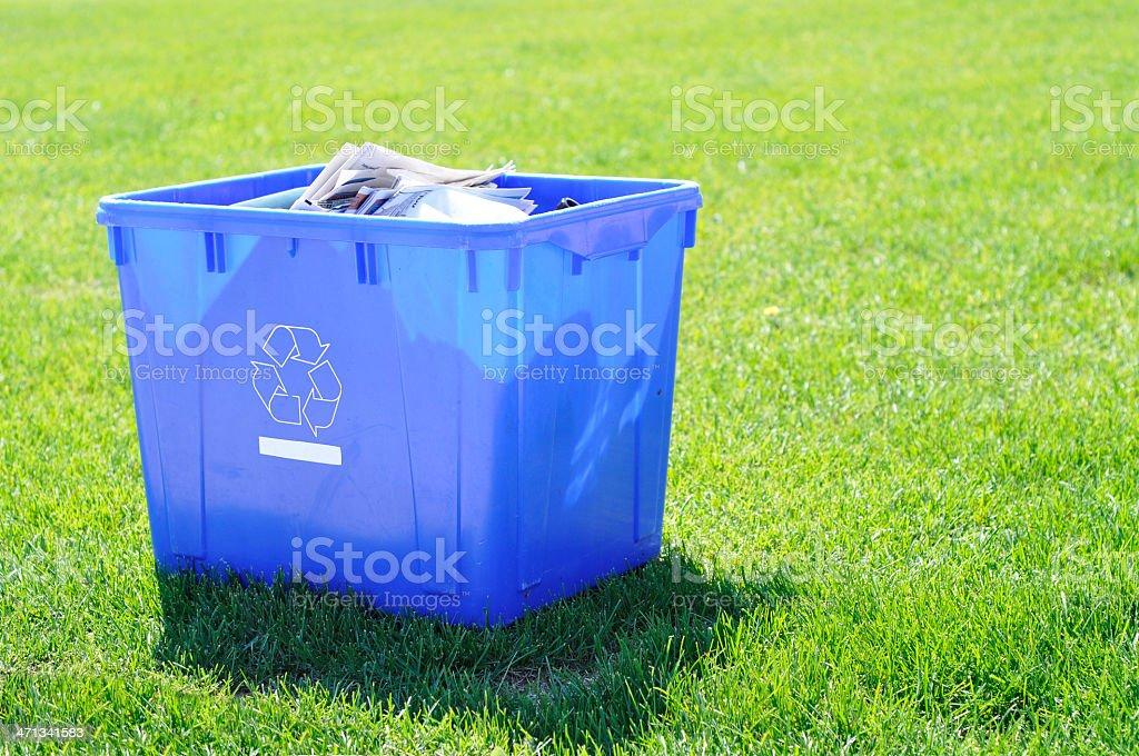 recycling bin on green grass royalty-free stock photo