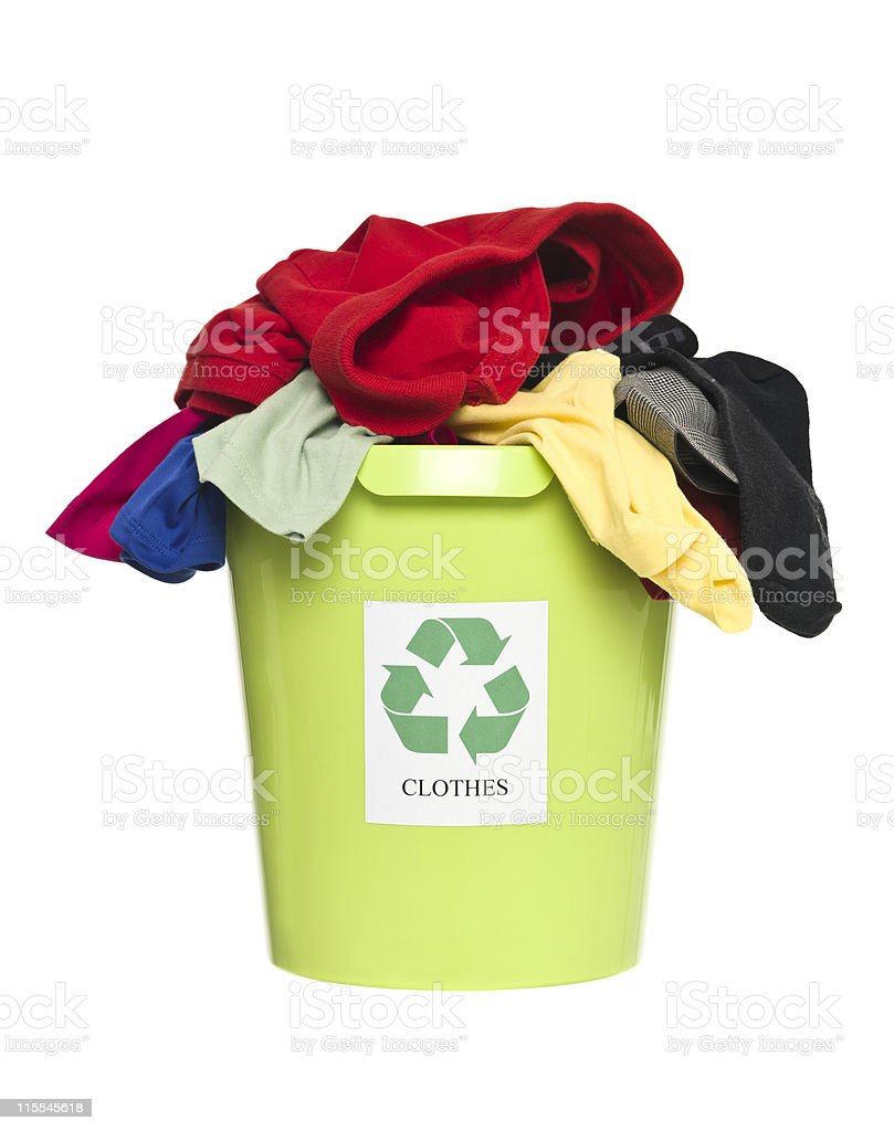 Recycling bin with clothes royalty-free stock photo