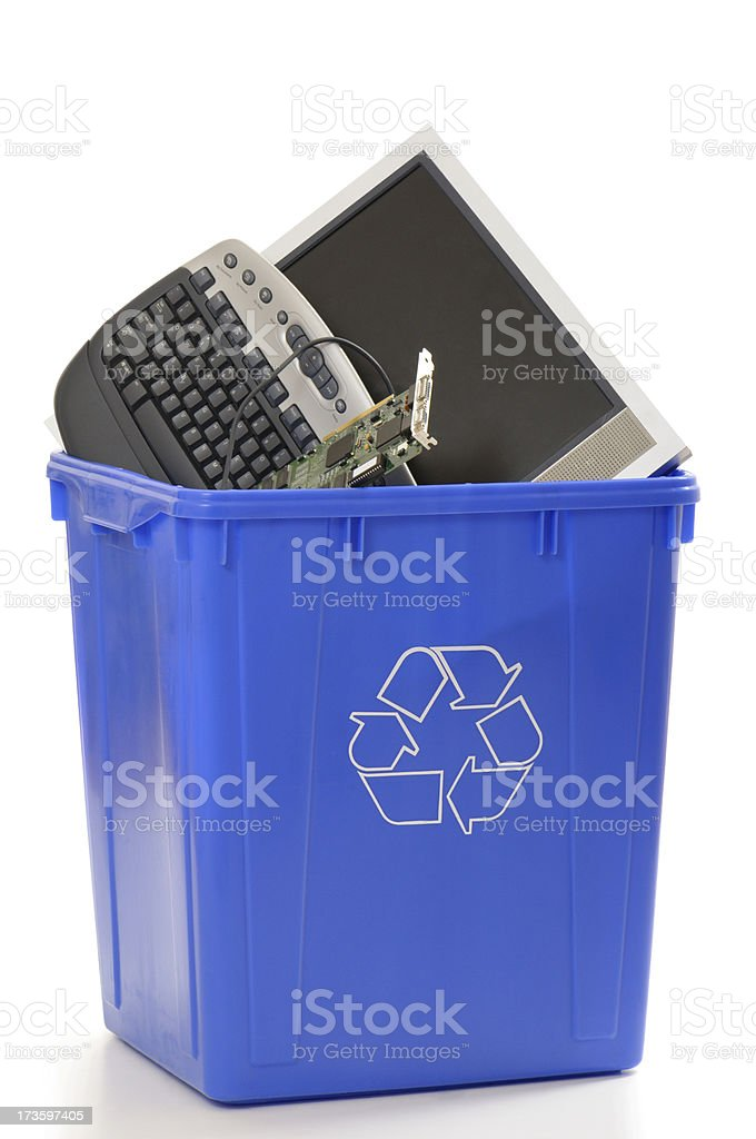 Recycling bin with computer parts royalty-free stock photo