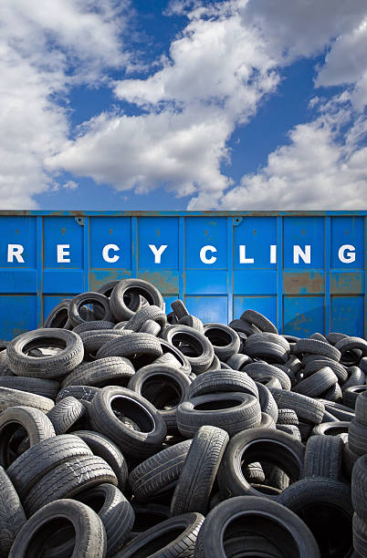 Recycling business container and tires stock photo