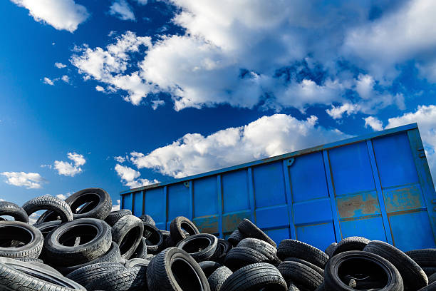 Recycling business, container and tires stock photo