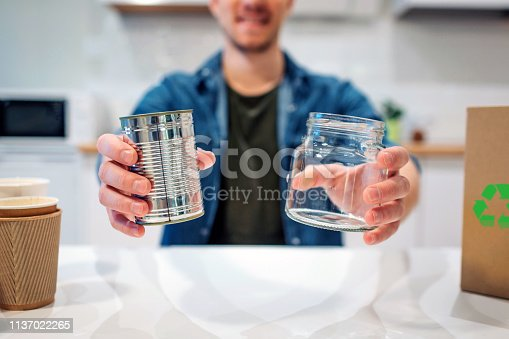 1137022221 istock photo Recycling concept. Metal tin can and glass are prepared for recycling close-up 1137022265