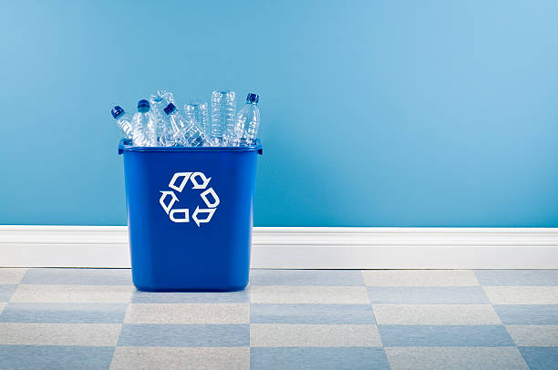recycling container with plastic bottles - recycling symbol stock photos and pictures
