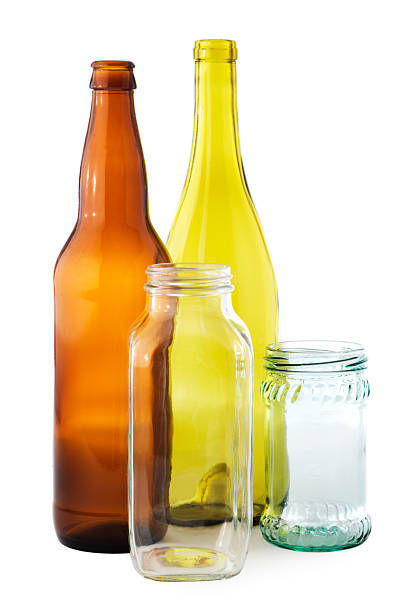 Recycling Glass Bottles and Jars Containers, Isolated on White Background Subject: A collection of recyclable glass containers bottle bank stock pictures, royalty-free photos & images