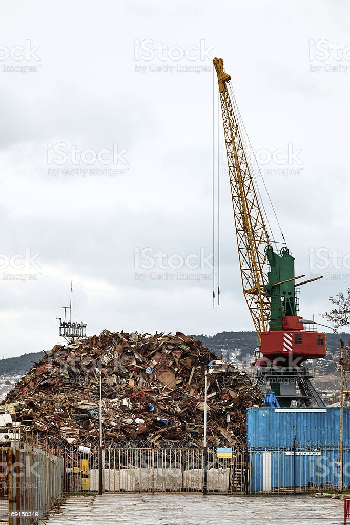 Recycling, loading scrap metal in the ship royalty-free stock photo