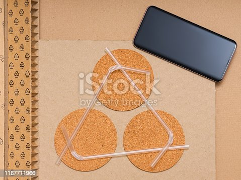 istock Recycling materials and mobile phone (screen and mobilephone have a path) 1167711966