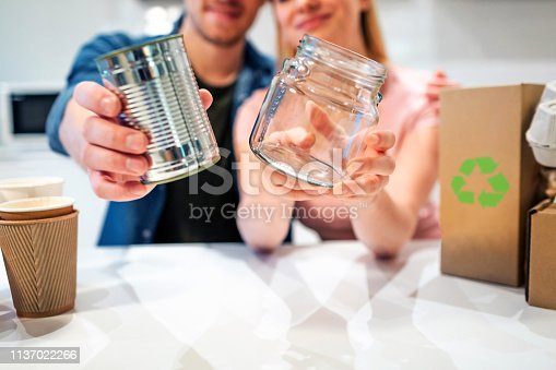 1137022221 istock photo Recycling. Metal tin can and glass are prepared for recycling close-up 1137022266