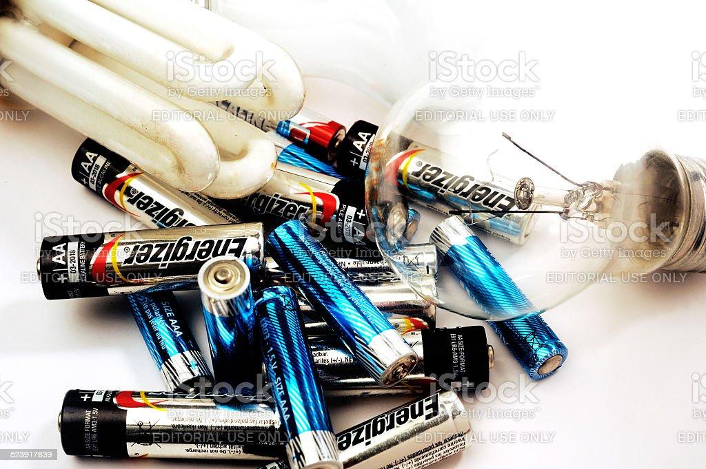 Recycling of used batteries and bulbs bildbanksfoto