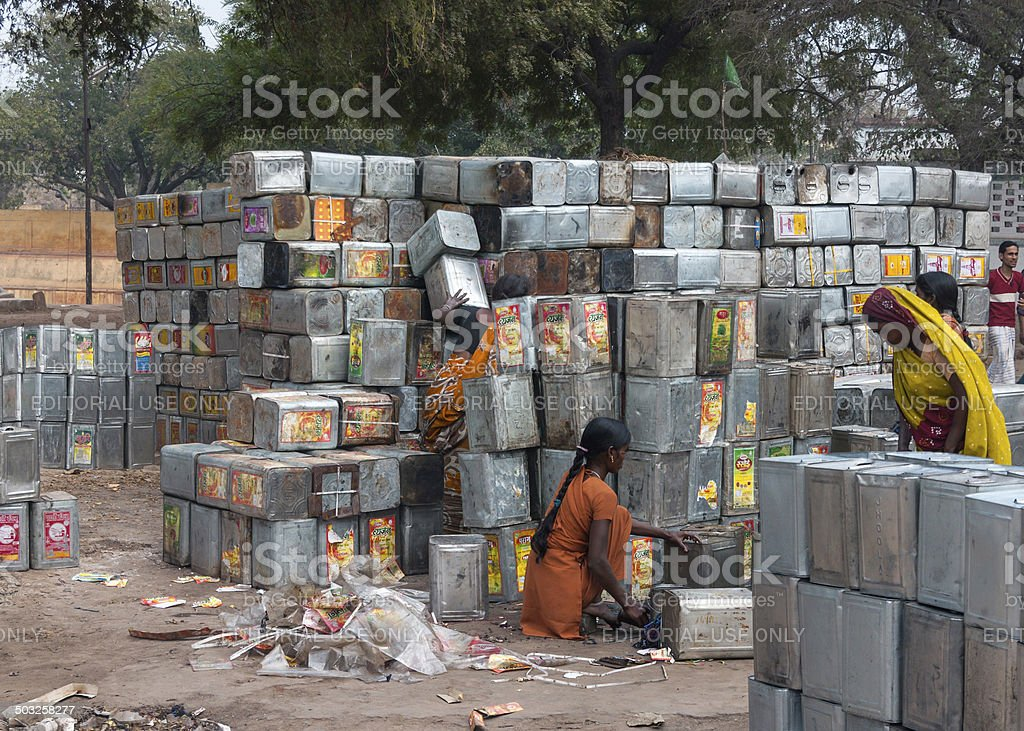 Recycling operation of empty metal cooking oil cans. stock photo