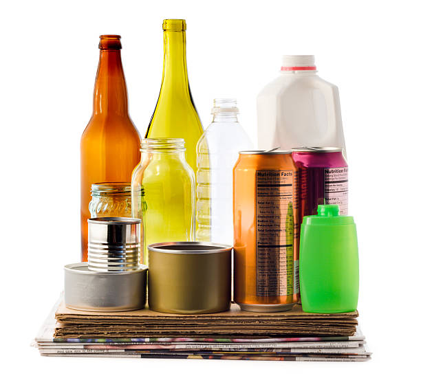Recycling Packaging Material, Paper, Cardboard, Bottles, Plastic, Glass Cans A collection of household recyclable material, including glass bottles and jars, plastic containers, tin, iron and aluminum cans, newspaper, and cardboard packaging. Cut out and isolated on white background, with no people. bottle bank stock pictures, royalty-free photos & images