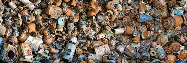 recycling: pile of electrical scrap motors and generators at junkyard - economia circular imagens e fotografias de stock