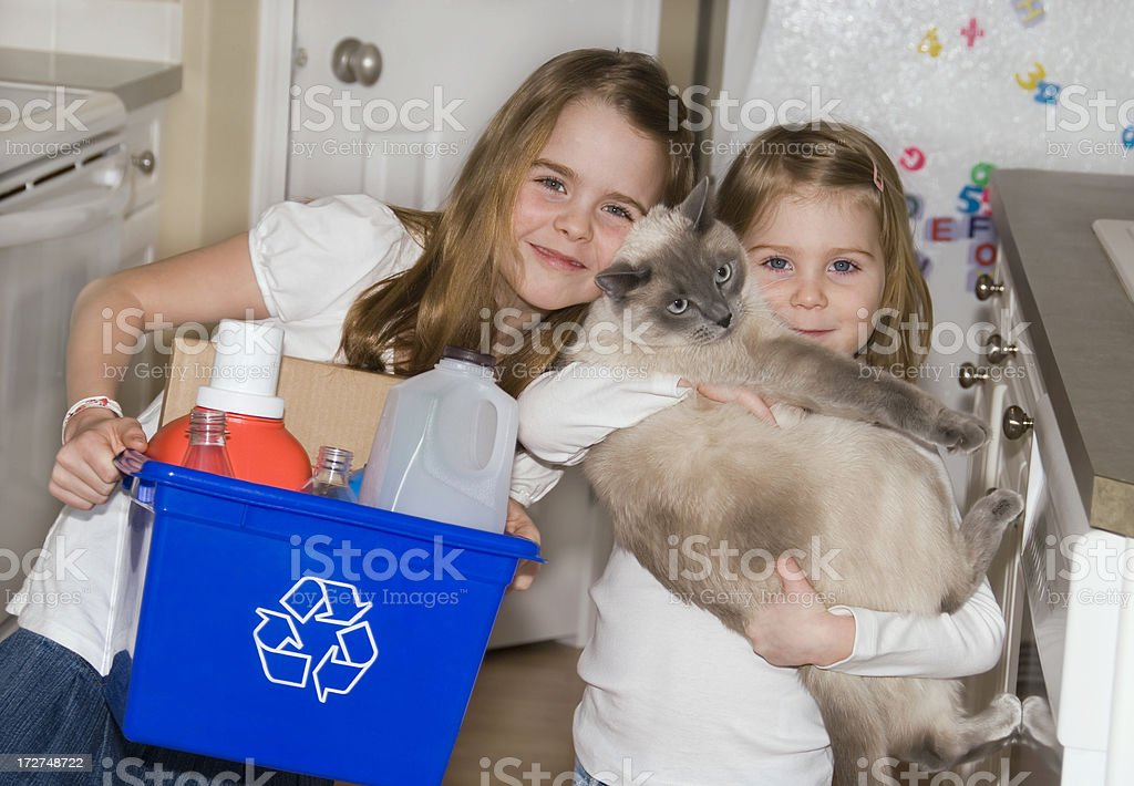 Recycling Sisters stock photo