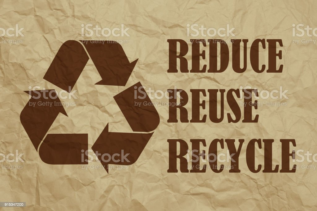 Recycling Symbol And Texts On Brown Crumpled Paper Stock Photo Istock