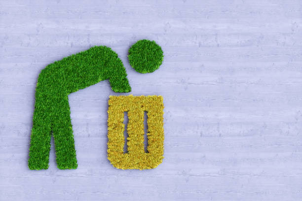 Recycling symbol artificial person trash bin made out of grass on wood stock photo