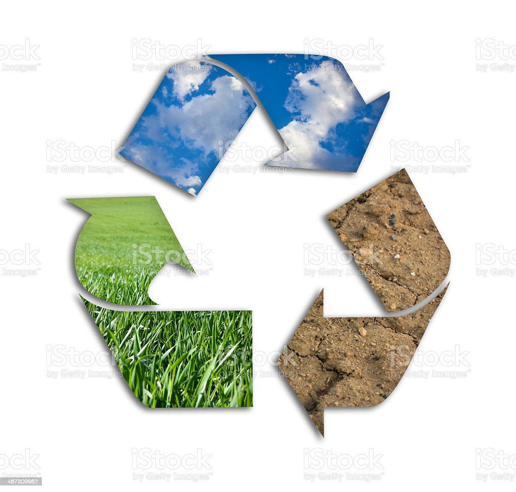 Recycling symbol made from mud, grass and air stock photo