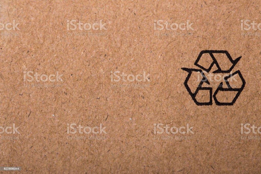 Recycling symbol on cardboard