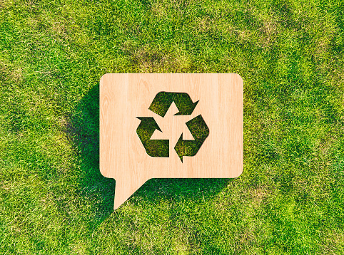 recycling symbol on grass