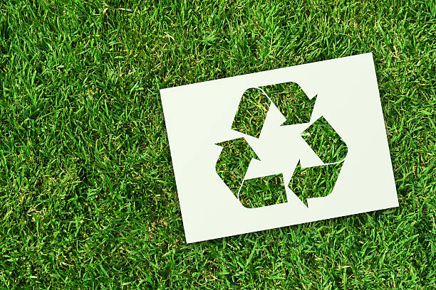 recycling symbol on grass - recycling symbol stock photos and pictures