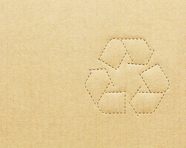 recycling symbol on tan cardboard box - recycling symbol stock photos and pictures
